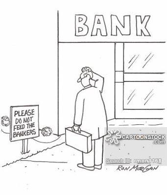 Man at bank sees sign: Please Do Not Feed The Bankers.
